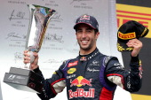 Daniel Ricciardo of Australia and Infiniti Red Bull Racing celebrates victory with the trophy on the podium after the Hungarian Formula One Grand...