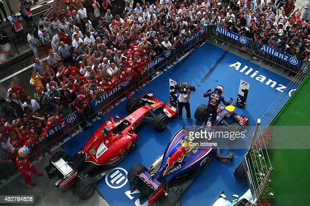 Daniel Ricciardo of Australia and Infiniti Red Bull Racing celebrates victory in Parc Ferme after the Hungarian Formula One Grand Prix at Hungaroring...