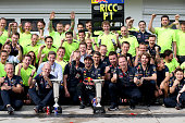 Daniel Ricciardo of Australia and Infiniti Red Bull Racing celebrates victory with the trophy in the pit lane after the Hungarian Formula One Grand...