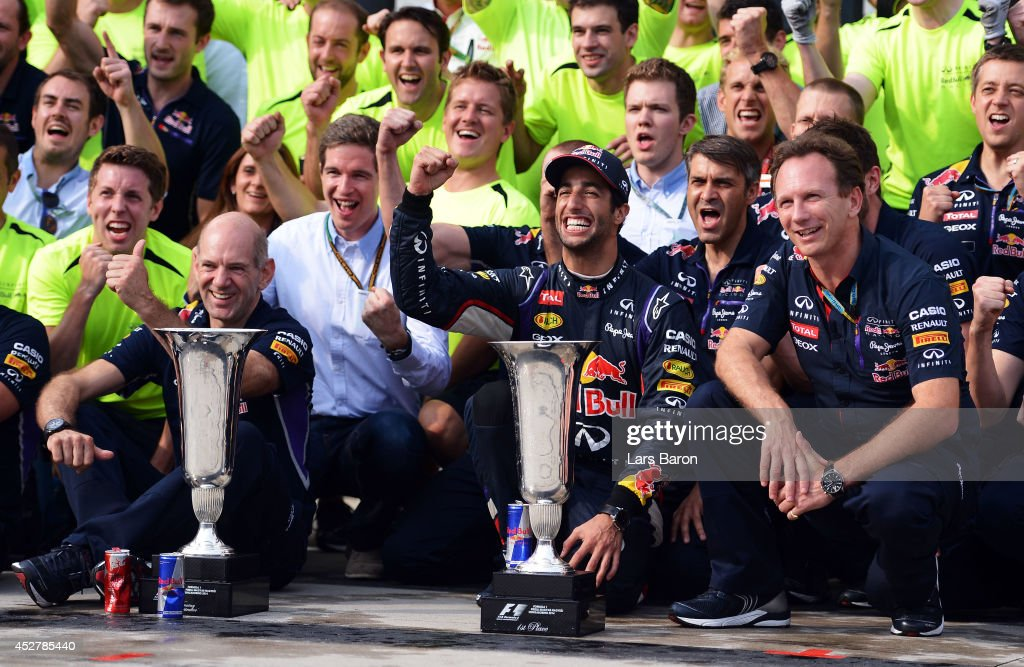 <a gi-track='captionPersonalityLinkClicked' href=/galleries/search?phrase=Daniel+Ricciardo&family=editorial&specificpeople=6547569 ng-click='$event.stopPropagation()'>Daniel Ricciardo</a> of Australia and Infiniti Red Bull Racing celebrates victory with the trophy and members of his team including Infiniti Red Bull Racing Team Principal <a gi-track='captionPersonalityLinkClicked' href=/galleries/search?phrase=Christian+Horner&family=editorial&specificpeople=228706 ng-click='$event.stopPropagation()'>Christian Horner</a> and <a gi-track='captionPersonalityLinkClicked' href=/galleries/search?phrase=Adrian+Newey&family=editorial&specificpeople=215410 ng-click='$event.stopPropagation()'>Adrian Newey</a>, the Infiniti Red Bull Racing Chief Technical Officer in the pit lane after the Hungarian Formula One Grand Prix at Hungaroring on July 27, 2014 in Budapest, Hungary.