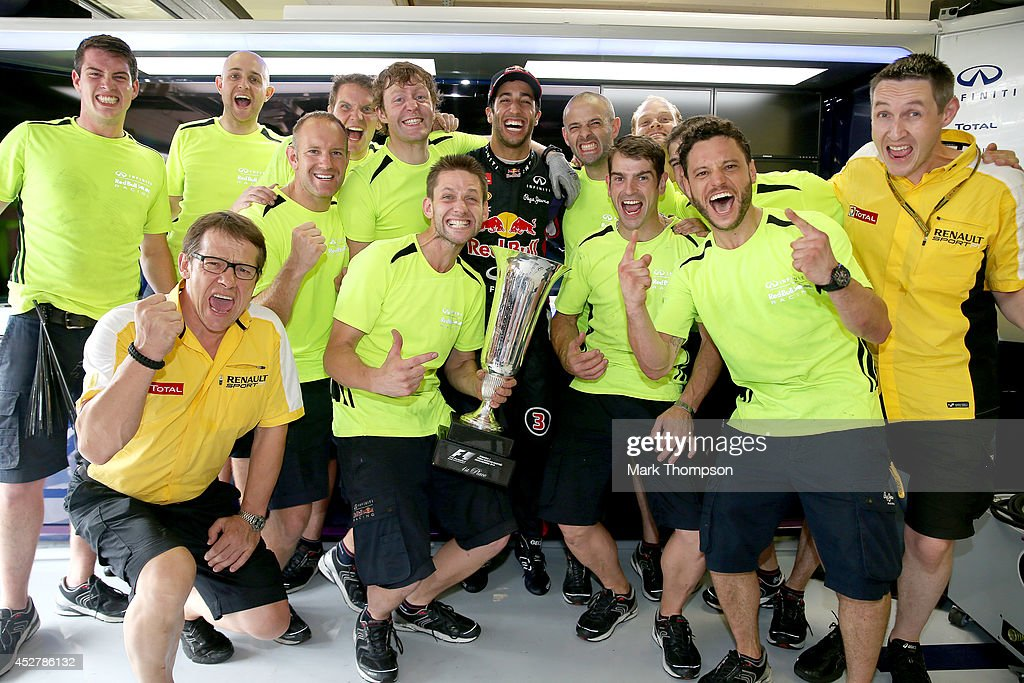 <a gi-track='captionPersonalityLinkClicked' href=/galleries/search?phrase=Daniel+Ricciardo&family=editorial&specificpeople=6547569 ng-click='$event.stopPropagation()'>Daniel Ricciardo</a> of Australia and Infiniti Red Bull Racing celebrates victory with his team and the trophy in the garage after the Hungarian Formula One Grand Prix at Hungaroring on July 27, 2014 in Budapest, Hungary.