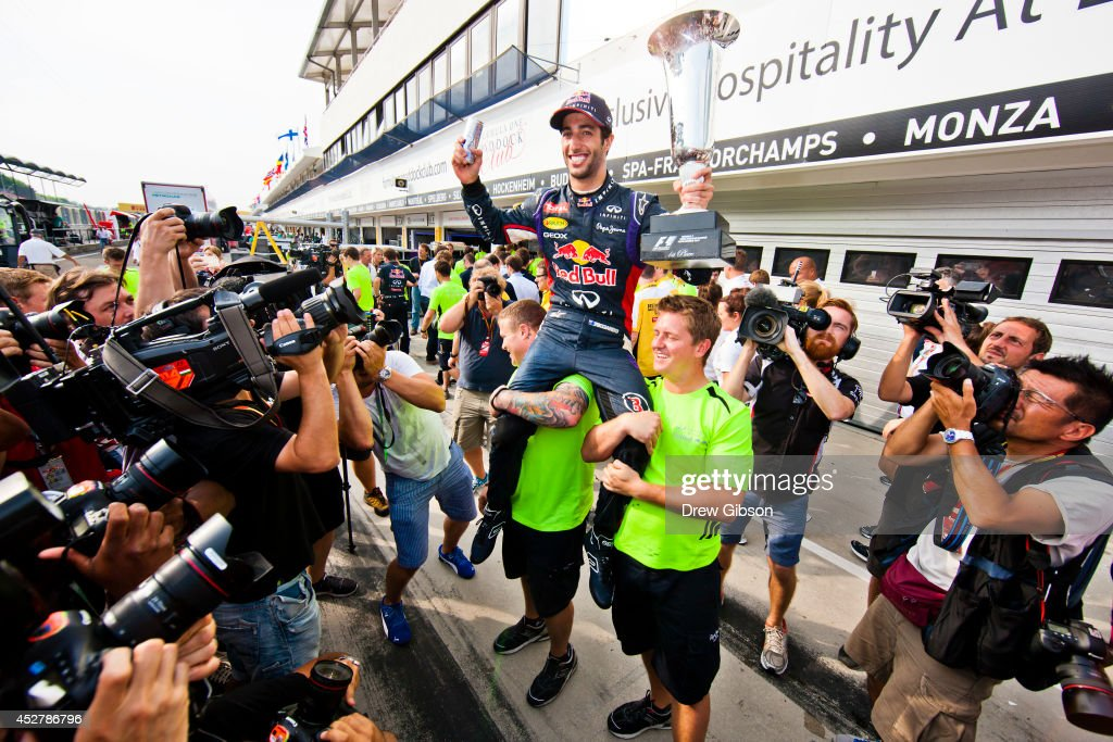 <a gi-track='captionPersonalityLinkClicked' href=/galleries/search?phrase=Daniel+Ricciardo&family=editorial&specificpeople=6547569 ng-click='$event.stopPropagation()'>Daniel Ricciardo</a> of Australia and Infiniti Red Bull Racing celebrates victory with the trophy in the pit lane after the Hungarian Formula One Grand Prix at Hungaroring on July 27, 2014 in Budapest, Hungary.