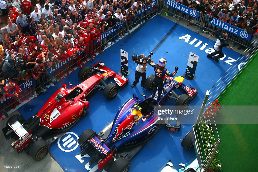 <a gi-track='captionPersonalityLinkClicked' href=/galleries/search?phrase=Daniel+Ricciardo&family=editorial&specificpeople=6547569 ng-click='$event.stopPropagation()'>Daniel Ricciardo</a> of Australia and Infiniti Red Bull Racing celebrates victory in Parc Ferme after the Hungarian Formula One Grand Prix at Hungaroring on July 27, 2014 in Budapest, Hungary.