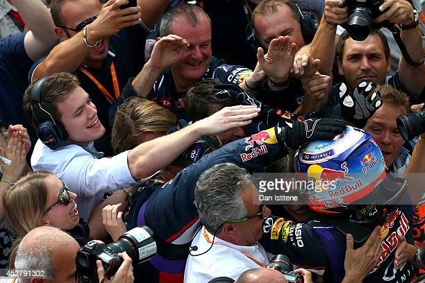 Daniel Ricciardo of Australia and Infiniti Red Bull Racing celebrates victory in Parc Ferme after the Hungarian Formula One Grand Prix at Hungaroring...