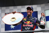 Daniel Ricciardo of Australia and Infiniti Red Bull Racing celebrates on the podium after winning the Belgian Grand Prix at Circuit de...