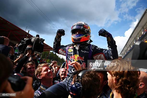 Daniel Ricciardo of Australia and Infiniti Red Bull Racing celebrates in Parc Ferme after winning the Belgian Grand Prix at Circuit de...