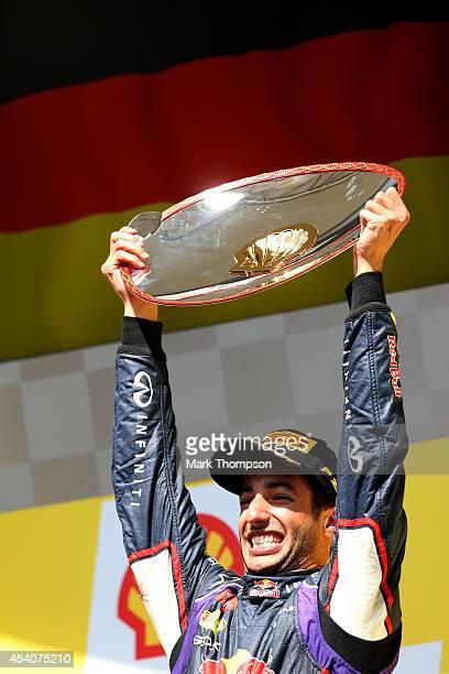 Daniel Ricciardo of Australia and Infiniti Red Bull Racing celebrates on the podium after winning the Belgian Grand Prix at Circuit de...