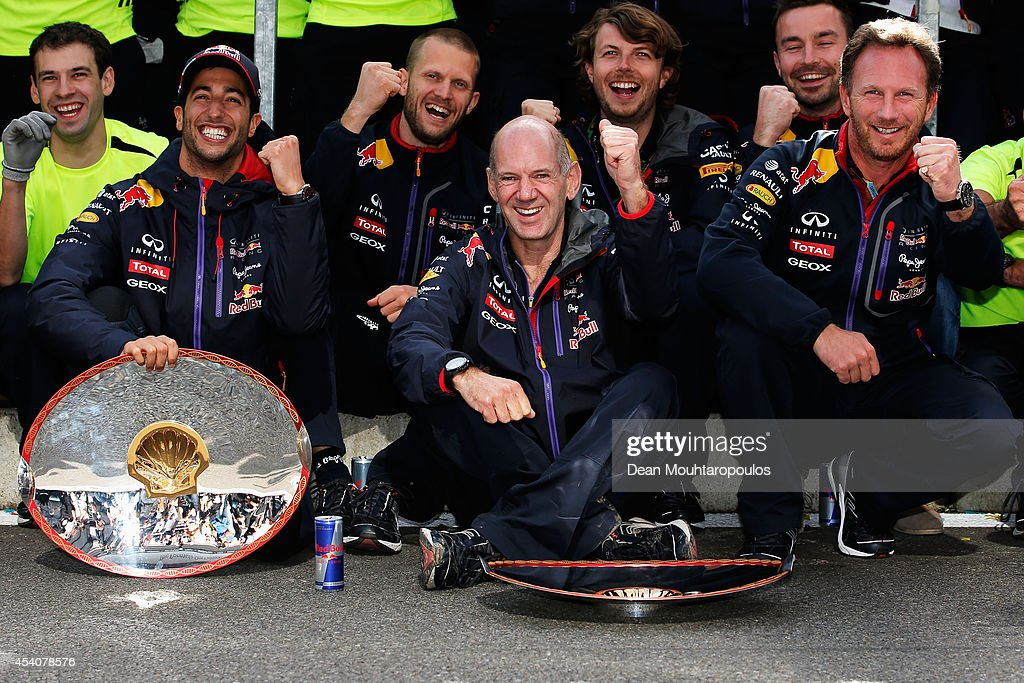Daniel Ricciardo of Australia and Infiniti Red Bull Racing celebrates with the team including Team Principal Christian Horner and Adrian Newey, the Chief Technical Officer in the pit lane after winning the Belgian Grand Prix at Circuit de Spa-Francorchamps on August 24, 2014 in Spa, Belgium.
