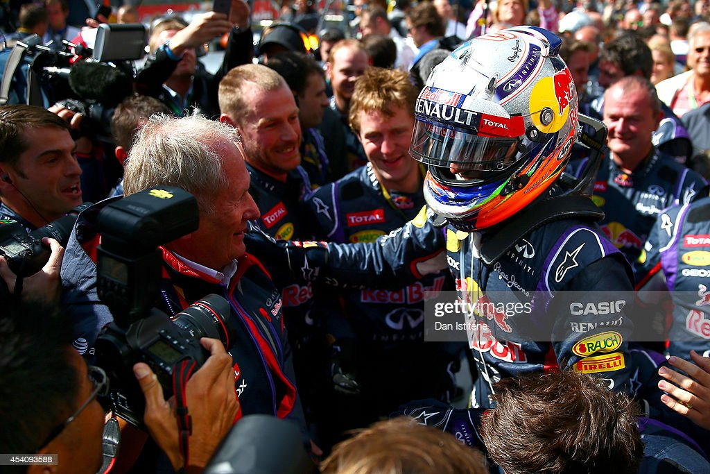 Daniel Ricciardo of Australia and Infiniti Red Bull Racing celebrates in Parc Ferme with Dr Helmut Marko after winning the Belgian Grand Prix at Circuit de Spa-Francorchamps on August 24, 2014 in Spa, Belgium.