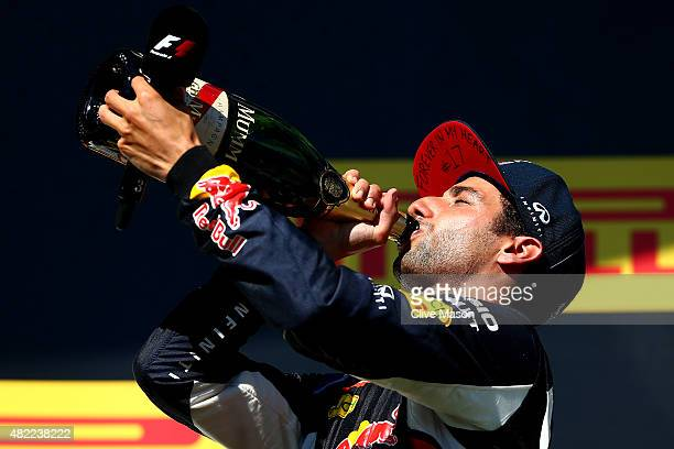 Daniel Ricciardo of Australia and Infiniti Red Bull Racing celebrates on the podium after finsihing third during the Formula One Grand Prix of...