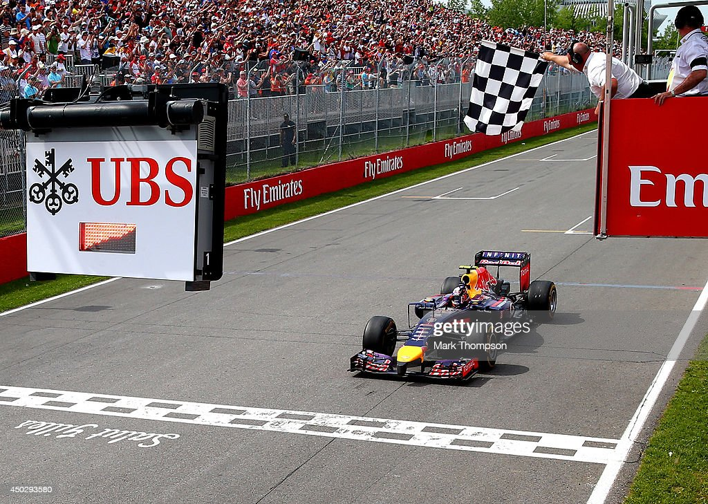 Daniel Ricciardo of Australia and Infiniti Red Bull Racing crosses the finish line to take his first Grand Prix victory during the Canadian Formula...