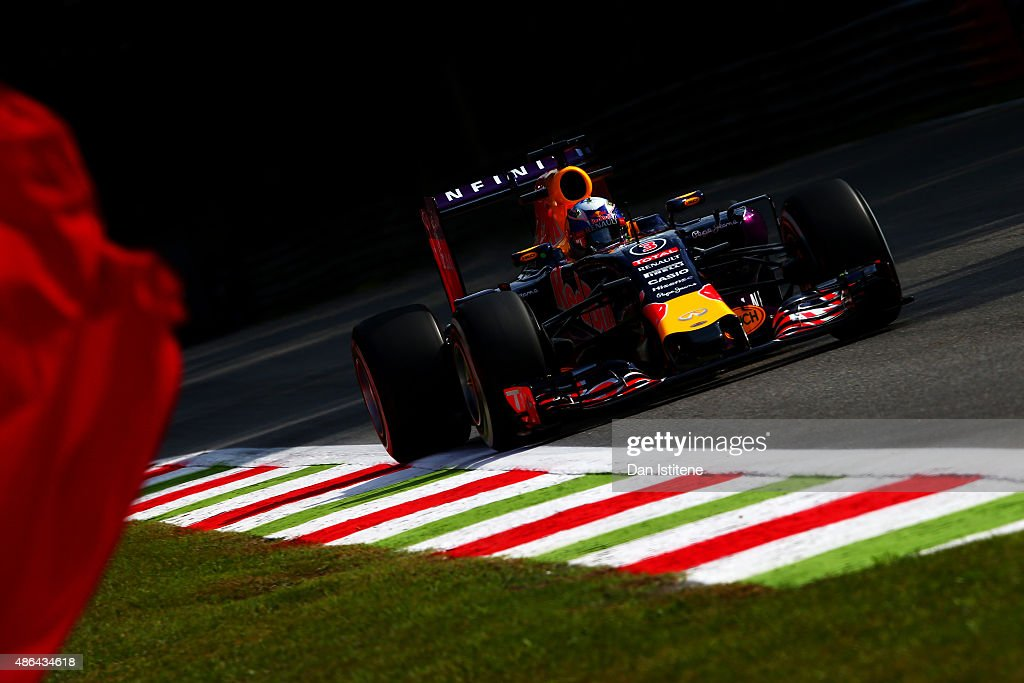Daniel Ricciardo of Australia and Infiniti Red Bull Racing drives as a marshall waves a red flag during practice for the Formula One Grand Prix of...