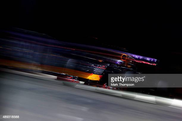 Daniel Ricciardo of Australia and Infiniti Red Bull Racing drives during the Formula One Grand Prix of Singapore at Marina Bay Street Circuit on...