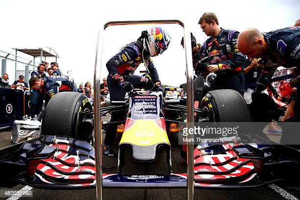 Daniel Ricciardo of Australia and Infiniti Red Bull Racing gets out of his car on the grid before the Formula One Grand Prix of Hungary at...