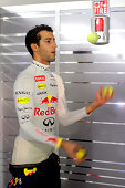 Daniel Ricciardo of Australia and Infiniti Red Bull Racing juggles tennis balls in the team garage during Practice ahead of the F1 Grand Prix of...