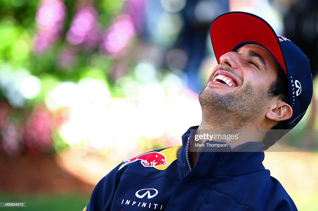 Daniel Ricciardo of Australia and Infiniti Red Bull Racing laughs as he speaks with members of the media in the paddock during previews to the Australian Formula One Grand Prix at Albert Park on March 12, 2015 in Melbourne, Australia.
