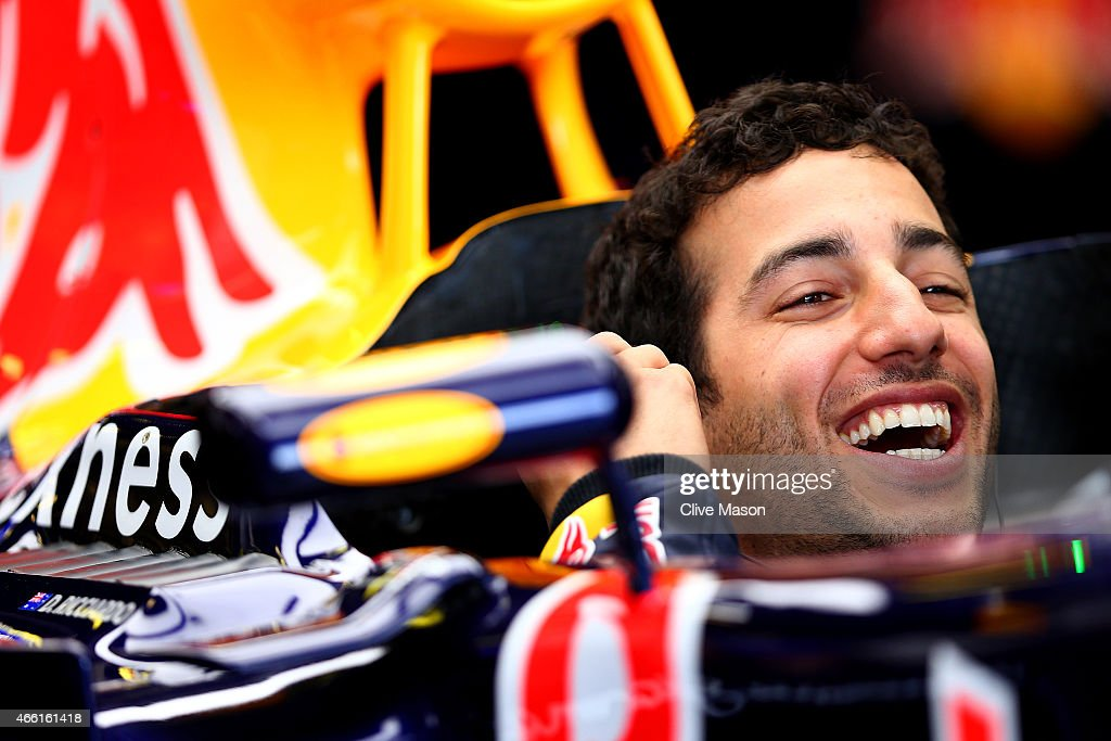 Daniel Ricciardo of Australia and Infiniti Red Bull Racing laughs as he sits in his car in the garage during final practice for the Australian...