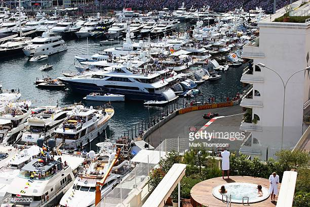 Daniel Ricciardo of Australia and Infiniti Red Bull Racing leads from Kimi Raikkonen of Finland and Ferrari during the Monaco Formula One Grand Prix...