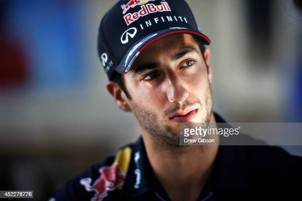 Daniel Ricciardo of Australia and Infiniti Red Bull Racing looks on as he takes part in an interview during previews ahead of the German Grand Prix...