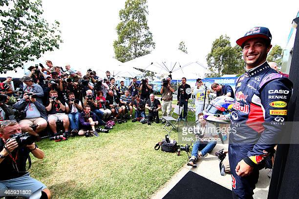 Daniel Ricciardo of Australia and Infiniti Red Bull Racing poses for photographers in the paddock during previews to the Australian Formula One Grand...
