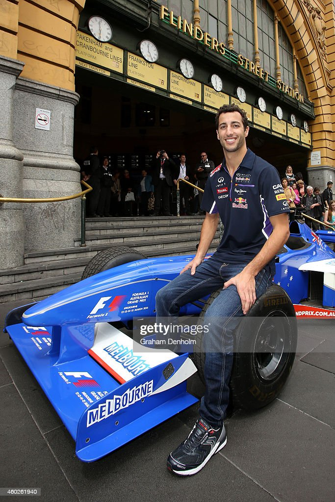 Daniel Ricciardo of Australia and Infiniti Red Bull Racing poses on a Formula 1 car at the steps of Flinders Street Station during the 2015 Formula 1...