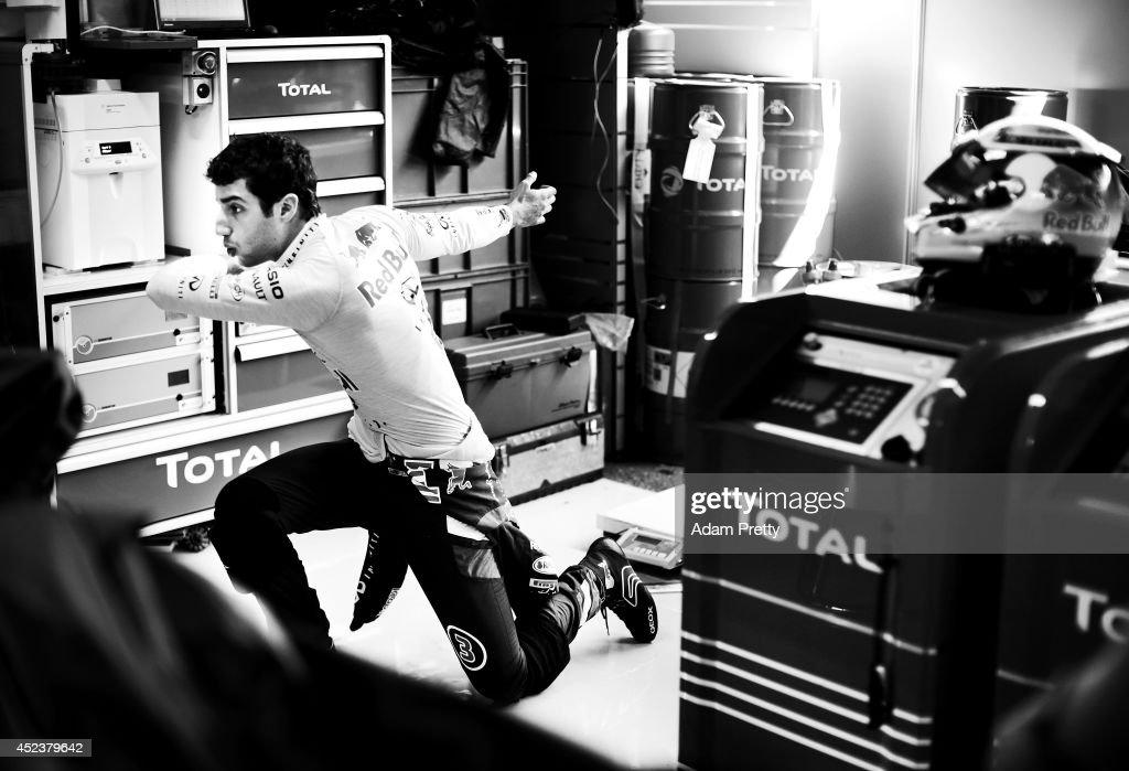 Daniel Ricciardo of Australia and Infiniti Red Bull Racing prepares in the garage during final practice ahead of the German Grand Prix at...