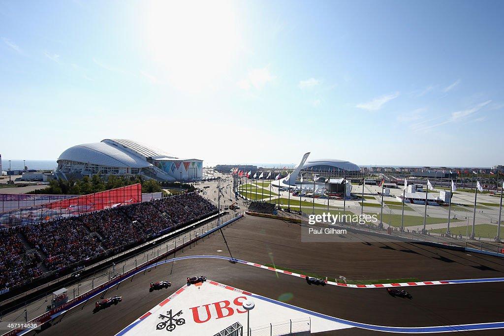 Daniel Ricciardo of Australia and Infiniti Red Bull Racing Sebastian Vettel of Germany and Infiniti Red Bull Racing Daniil Kvyat of Russia and...