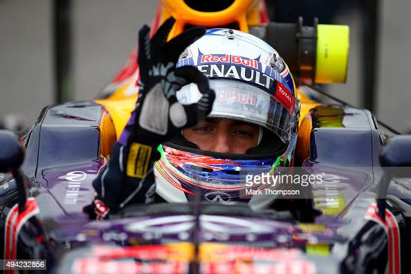 Daniel Ricciardo of Australia and Infiniti Red Bull Racing signals to his team from his car on the grid before the United States Formula One Grand...