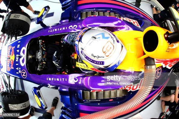 Daniel Ricciardo of Australia and Infiniti Red Bull Racing sits in his car in the garage during qualifying ahead of the Austrian Formula One Grand...