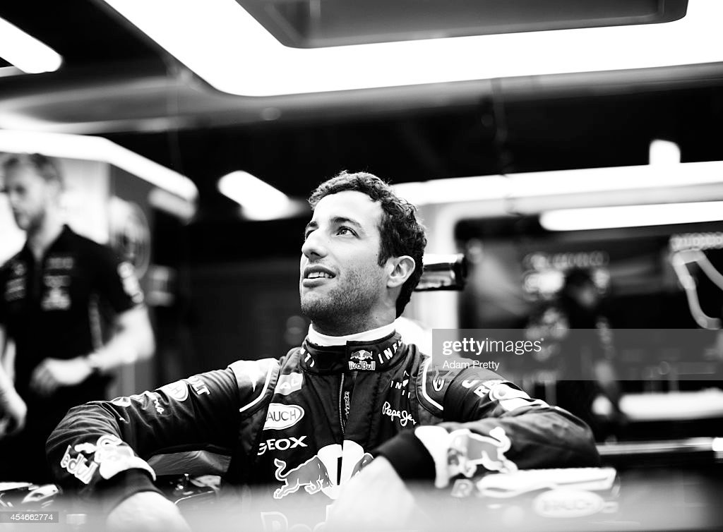 Daniel Ricciardo of Australia and Infiniti Red Bull Racing sits in his car in the team garage during Previews ahead of the F1 Grand Prix of Italy at...