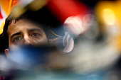 Daniel Ricciardo of Australia and Infiniti Red Bull Racing sits in his car in the garage during qualifying for the Abu Dhabi Formula One Grand Prix...