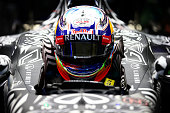 Daniel Ricciardo of Australia and Infiniti Red Bull Racing sits in his car in the garage during day one of Formula One Winter Testing at Circuito de...