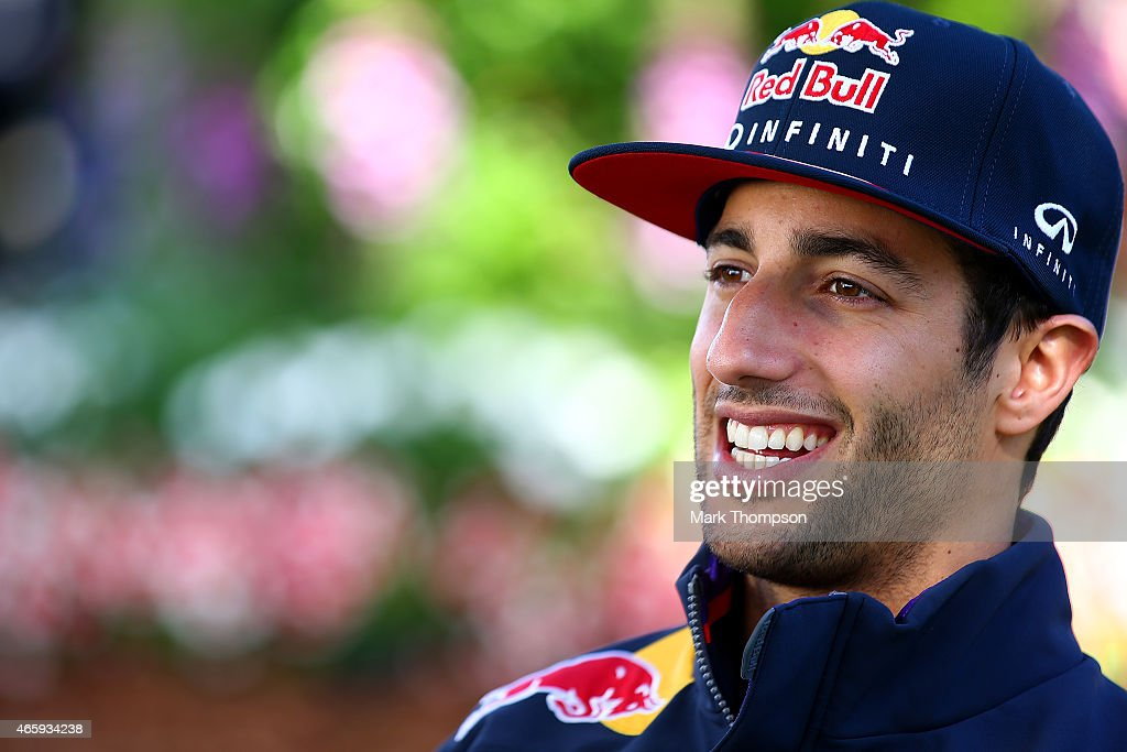Daniel Ricciardo of Australia and Infiniti Red Bull Racing smiles as he speaks with members of the media in the paddock during previews to the Australian Formula One Grand Prix at Albert Park on March 12, 2015 in Melbourne, Australia.