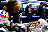 Daniel Ricciardo of Australia and Infiniti Red Bull Racing speaks with Stuart Smith in the garage during day three of the final Formula One Winter...