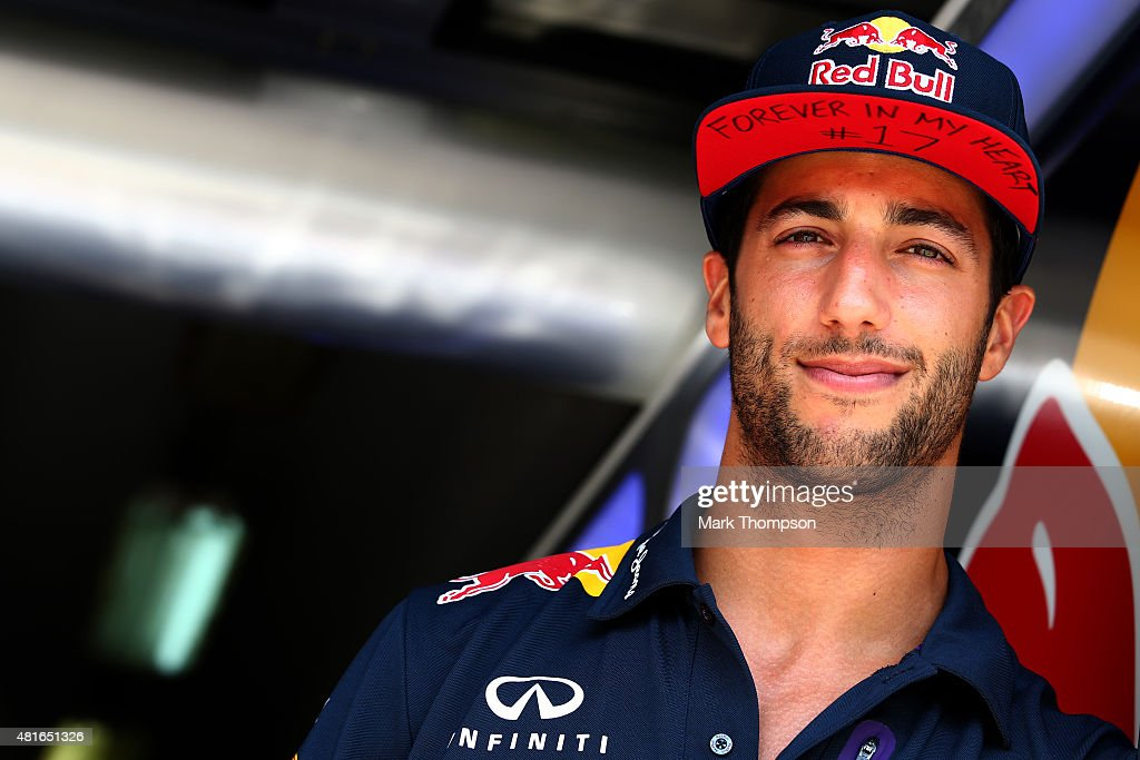Daniel Ricciardo of Australia and Infiniti Red Bull Racing stands in the garage wearing a cap displaying a message in memory of Jules Bianchi during previews to the Formula One Grand Prix of Hungary at Hungaroring on July 23, 2015 in Budapest, Hungary.