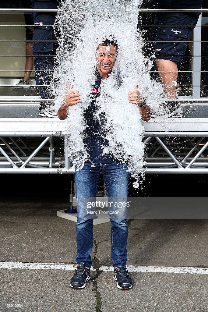Daniel Ricciardo of Australia and Infiniti Red Bull Racing takes part in an ice bucket challenge during previews ahead of the Belgian Grand Prix at Circuit de Spa-Francorchamps on August 21, 2014 in Spa, Belgium.