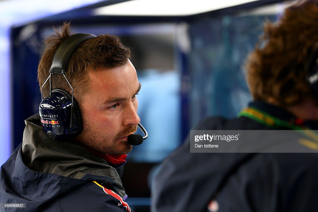 Daniel Ricciardo of Australia and Infiniti Red Bull Racing's race engineer Simon Rennie works in the team garage during the Belgian Grand Prix at Circuit de Spa-Francorchamps on August 24, 2014 in Spa, Belgium.
