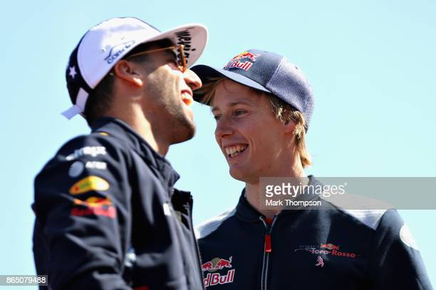 Daniel Ricciardo of Australia and Red Bull Racing and Brendon Hartley of New Zealand and Scuderia Toro Rosso on the drivers parade before the United...