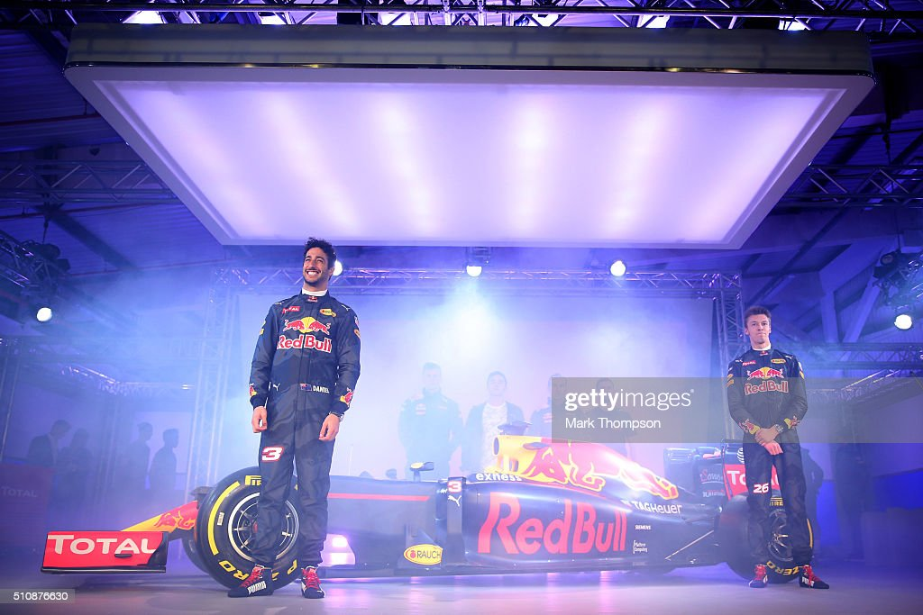 Daniel Ricciardo of Australia and Red Bull Racing and Daniil Kvyat of Russia and Red Bull Racing pose on stage next to the RB11 featuring the 2016...