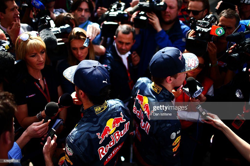 <a gi-track='captionPersonalityLinkClicked' href=/galleries/search?phrase=Daniel+Ricciardo&family=editorial&specificpeople=6547569 ng-click='$event.stopPropagation()'>Daniel Ricciardo</a> of Australia and Red Bull Racing and <a gi-track='captionPersonalityLinkClicked' href=/galleries/search?phrase=Daniil+Kvyat&family=editorial&specificpeople=10936016 ng-click='$event.stopPropagation()'>Daniil Kvyat</a> of Russia and Red Bull Racing talk to the press in the Paddock during practice for the Formula One Grand Prix of Russia at Sochi Autodrom on April 29, 2016 in Sochi, Russia.