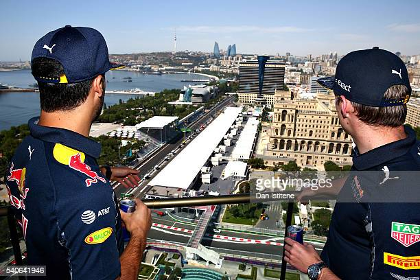 Daniel Ricciardo of Australia and Red Bull Racing and Max Verstappen of Netherlands and Red Bull Racing look over the circuit during previews ahead...