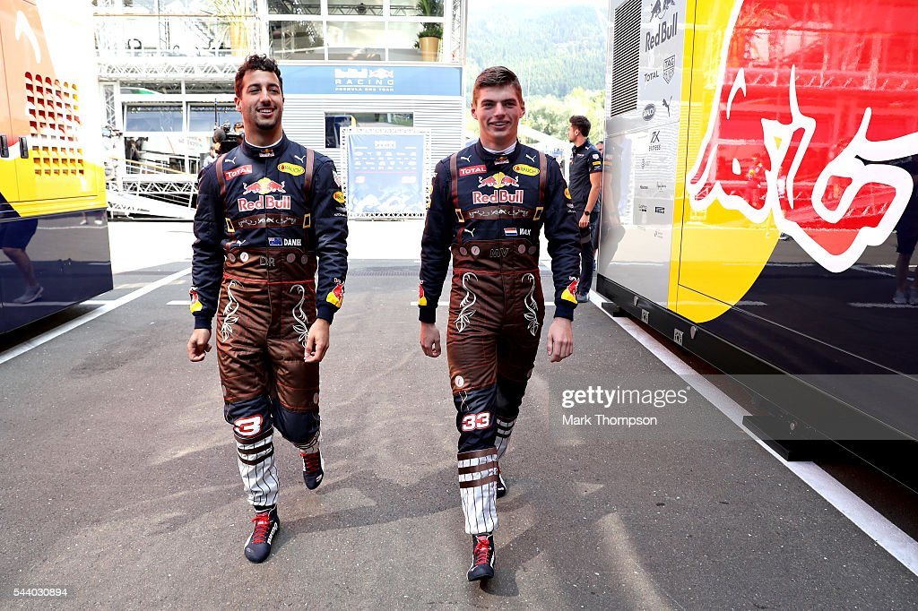 <a gi-track='captionPersonalityLinkClicked' href=/galleries/search?phrase=Daniel+Ricciardo&family=editorial&specificpeople=6547569 ng-click='$event.stopPropagation()'>Daniel Ricciardo</a> of Australia and Red Bull Racing and <a gi-track='captionPersonalityLinkClicked' href=/galleries/search?phrase=Max+Verstappen&family=editorial&specificpeople=12813205 ng-click='$event.stopPropagation()'>Max Verstappen</a> of Netherlands and Red Bull Racing walk to the garage in lederhosen themed overalls before practice for the Formula One Grand Prix of Austria at Red Bull Ring on July 1, 2016 in Spielberg, Austria.