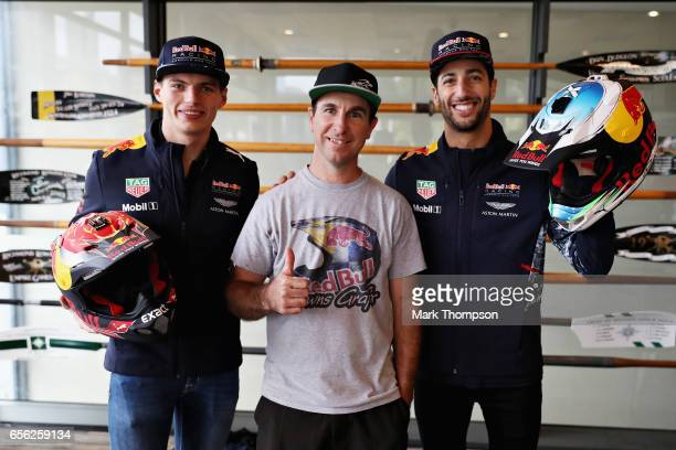 Daniel Ricciardo of Australia and Red Bull Racing and Max Verstappen of Netherlands and Red Bull Racing are presented with special edition helmets...