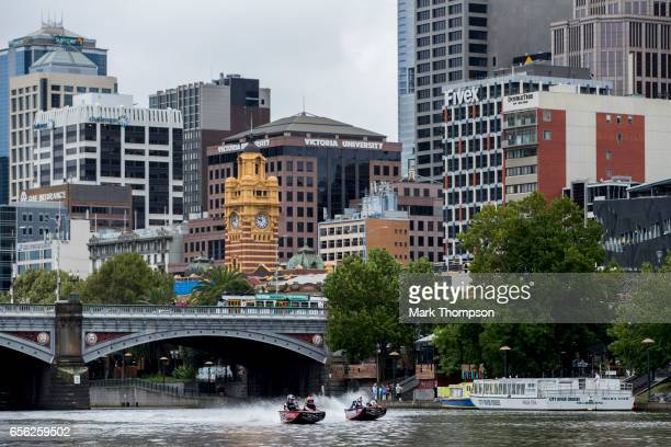 Daniel Ricciardo of Australia and Red Bull Racing and Max Verstappen of Netherlands and Red Bull Racing race on the Yarra River for the Red Bull...