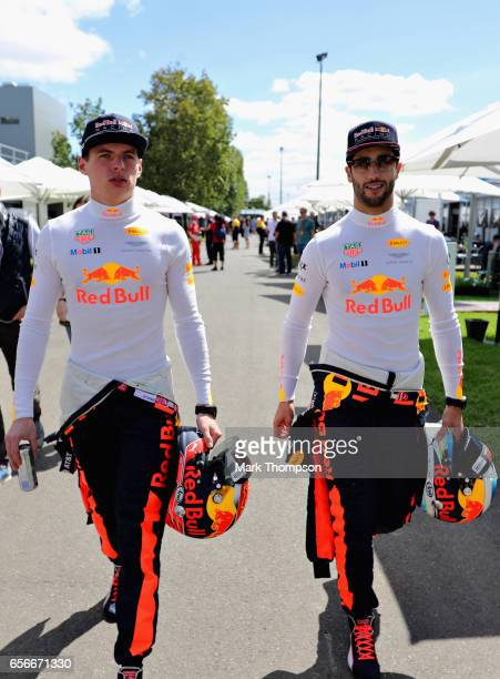 Daniel Ricciardo of Australia and Red Bull Racing and Max Verstappen of Netherlands and Red Bull Racing walk in the Paddock during previews to the...