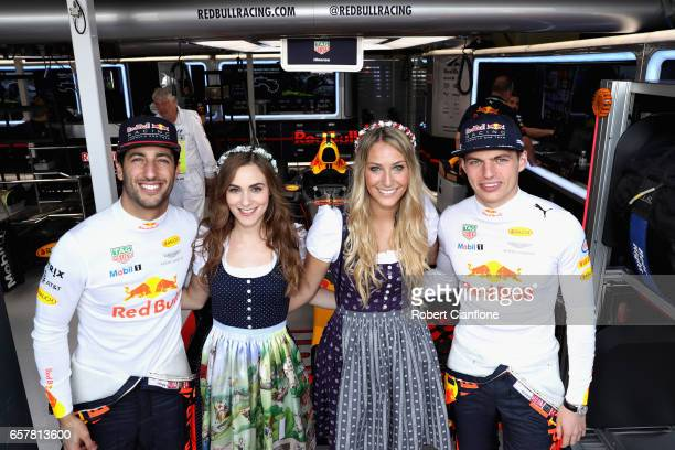 Daniel Ricciardo of Australia and Red Bull Racing and Max Verstappen of Netherlands and Red Bull Racing meet the Red Bull Racing Formula Unas outside...