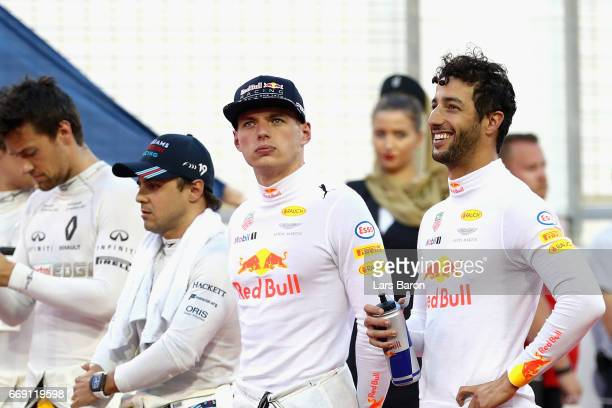 Daniel Ricciardo of Australia and Red Bull Racing and Max Verstappen of Netherlands and Red Bull Racing on the grid before the Bahrain Formula One...