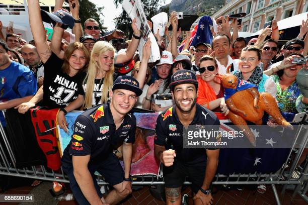 Daniel Ricciardo of Australia and Red Bull Racing and Max Verstappen of Netherlands and Red Bull Racing pose for a photo with fans during previews to...