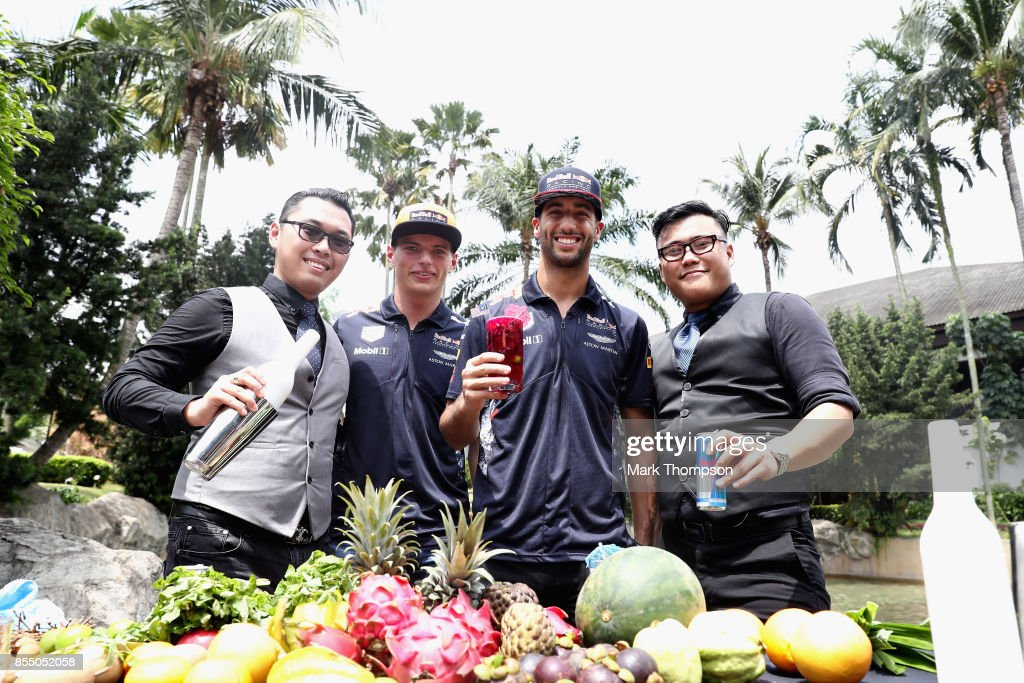 Daniel Ricciardo of Australia and Red Bull Racing and Max Verstappen of Netherlands and Red Bull Racing at a Red Bull Racing cocktail making event during previews for the Malaysia Formula One Grand Prix at Sepang Circuit on September 28, 2017 in Kuala Lumpur, Malaysia.