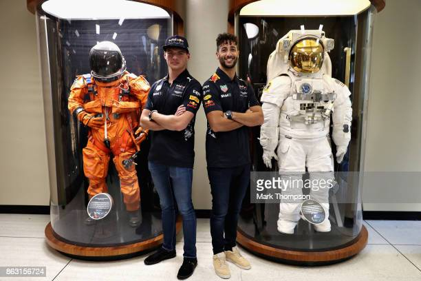 Daniel Ricciardo of Australia and Red Bull Racing and Max Verstappen of Netherlands and Red Bull Racing enjoy a trip to NASA Space Center during...